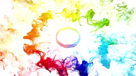 kreativitás : Multiple iridescent multicolored rainbow particle paint vivid colored powder smoke pulsating shockwave circle explosions logo copy space copyspace top view animation alpha 4k VJ loop isolated on white