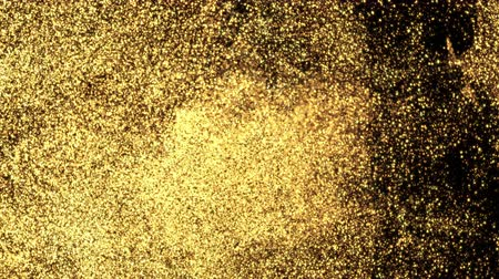 parçacık : Abstract sparkling glitter in water. Shiny golden particles swirling underwater in slow motion. Glamour art background. Flowing glittering fluid liquid animation. Isolated on black alpha channel Stok Video