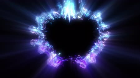 Blue purple color heart shaped Valentines Day particle love burst. Vivid colored glowing smoke shockwave. Romantic lovely logo and copy space gas animation. Isolated on black alpha copyspace 4k 60fps