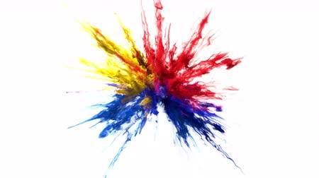 combustão : Red yellow blue color burst - colorful smoke powder explosion of swirly particles or ink fluid in slow motion. Alpha matte isolated on white 60 fps Vídeos