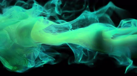 guache : Cyan turquoise color paint ink drops in water slow motion art background with copy space. Inky cloud swirling flowing underwater. Abstract smoke fluid  liquid animation isolated on black alpha channel Stock Footage