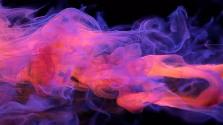 oil drop : Orange purple color paint ink drops in water slow motion art background with copy space. Inky cloud swirling flowing underwater. Abstract smoke fluid  liquid animation isolated on black alpha channel