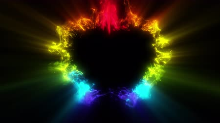 Iridescent multicolored heart shaped Valentines Day particle love burst. Vivid rainbow colored glowing smoke. Romantic lovely logo copy space gas animation. Isolated on black alpha copyspace 4k 60fps