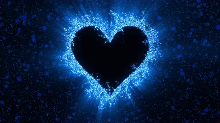 Blue shining heart shaped glitter background. St. Valentines Day love animation. Blurry bokeh defocused sparkles. Vivid colored glowing particles. Romantic lovely logo copy space. alpha copyspace 4k