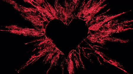 Ruby red shining glitter burst explosion forming a heart shaped hole. St. Valentines Day love animation. Vivid bokeh sparkles, glowing particles. Romantic lovely logo copy space. Alpha copyspace 4k Stok Video