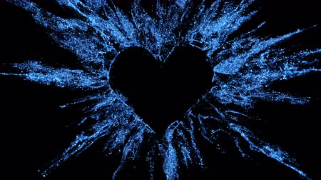 Sapphire blue shining glitter burst explosion forming a heart shaped hole. St. Valentines Day love animation. Vivid bokeh sparkles, glowing particles. Romantic lovely logo copy space. Alpha copyspace Stok Video