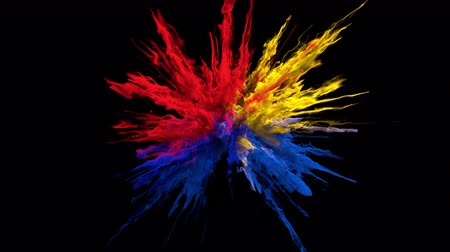 Color Burst - red blue yellow colorful smoke powder explosion or fluid ink particles in slow motion. Alpha matte isolated on black 60 fps. 4k ProRes422 Stok Video