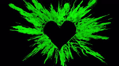Valentines Day green color burst forming a heart shaped hole. Vivid colored smoke powder explosion. Romantic colorful lovely ink logo and copy space. Isolated on black alpha copyspace 影像素材
