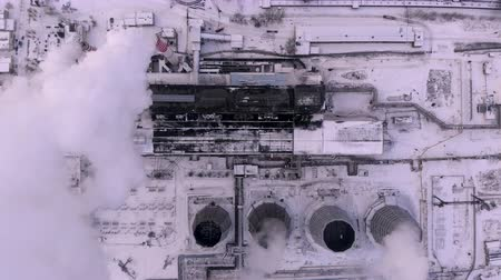 Aerial top view clouds of smoke and steam cooling tower industrial heat electro central coal. Environmental pollution concept