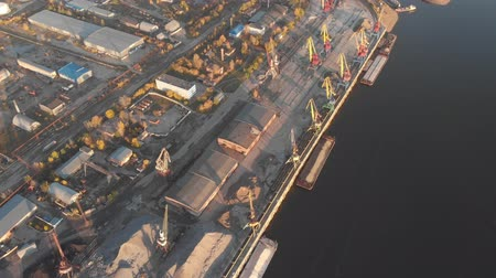 rusya : Port river cranes loading ships on barges delivery, sunset. Aerial drone Stok Video