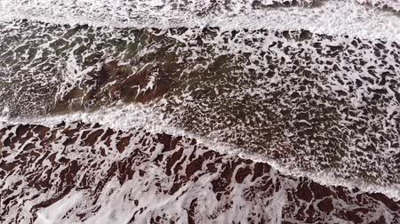 Aerail drone, Waves of sea with big foam, surfing spot, Italy Beach of Viareggio morning, Tuscany Versilia.