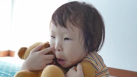alerji : Little Asian girl picking her nose ,slow motion Stok Video