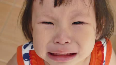 smutek : Close up young Asian girl is crying,footage in slow motion. Wideo