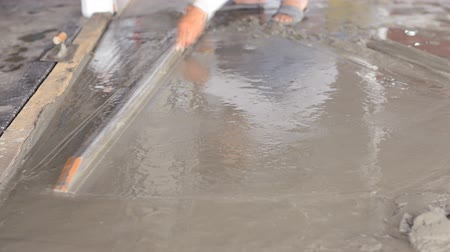 cement floor : Construction worker smooths concrete on the floor