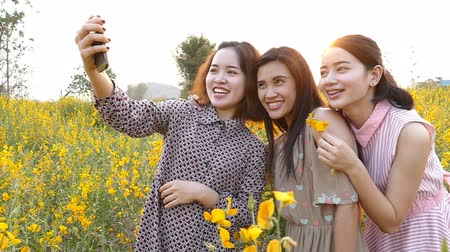 cellphone : Three Teenager girlfriends making self portrait by smart phone ,Slow motion Stock Footage
