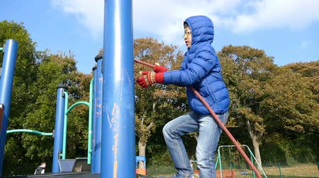 Young asian boy Play at Public Playground Wideo