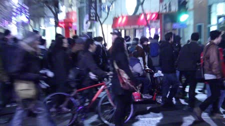 protesto : Man in wheelchair marching in a protest A man in a wheelchair is joining a protest downtown with skyscraper buildings at night in the background