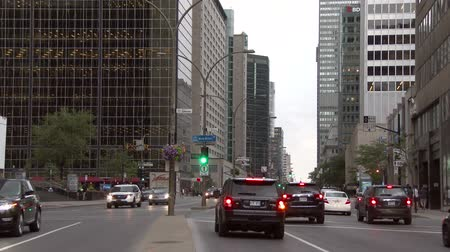limpid : 4K UHD TV Demo - Busy downtown street at dawn with cars and modern skyscrapers