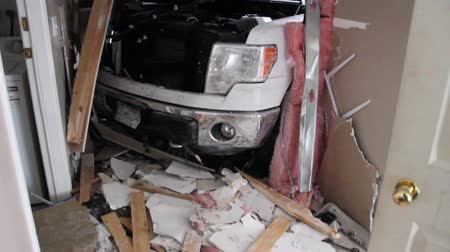 broken crash : Inside view of truck vs house accident View of inside the broken walls of a pickup truck crashed into a house with drywall debris.