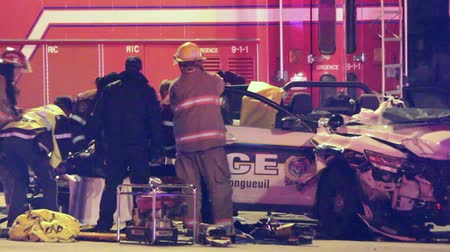 prowl : Emergency crews pull female police officer from car crash Numerous paramedics and firemen pull female police officer on spinal board from police car wreck onto a stretcher