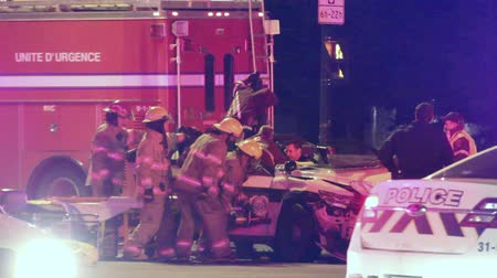 prowl : Extrication with jaws of life on police car wreck 3 fire fighters join their effort to open police cruiser door at violent crash.