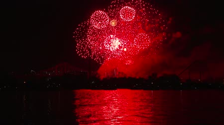 4K UHD - 60fps or 30fps - Zoom out on pyrotechnics display over the bay Stock Footage