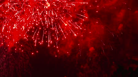 rachaduras : 4K UHD - 60fps or 30fps - Large red pyrotechnic balls exploding in night sky