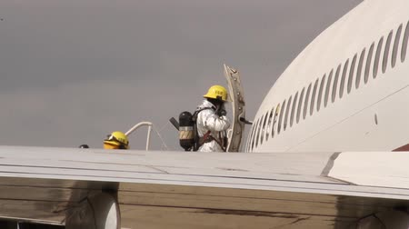 hazmat : Special airport unit fire crew entering large unmarked aircraft  - Commercial license no logo no face