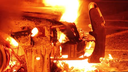 car logo : Closeup of wires and push bumper exposed during car fire  - Commercial license no logo no face Stock Footage