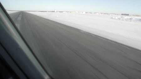 tomar : Airplane take off in winter seen from flight deck window  - Commercial license no logo no face