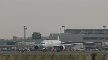 4K UHD - Boeing B777 Air Canada taxiing on tarmac and facing viewer Stock Footage