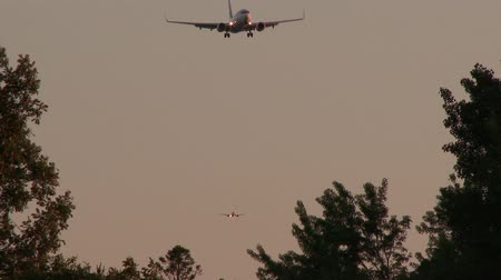 motor vehicle : 4K UHD - Two planes coming on landing towards camera during final approach