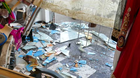 4K UHD - Inside view of smashed clothes store with debris after car crash