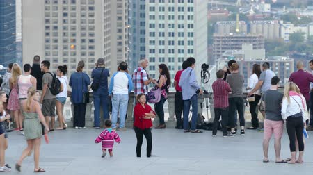 4K UHD - People taking pictures of buildings from high viewing platform