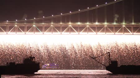 Bright fire rain falling down from bridge during high scale fireworks show Stock Footage