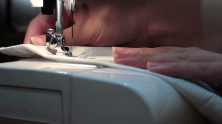clothing : sewing machine sews the seam stitch