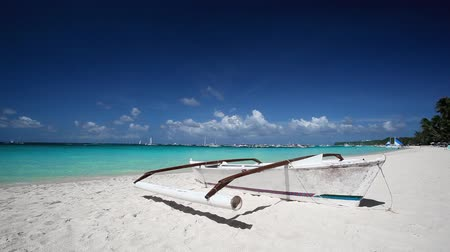 dominikana : Sailing boat on tropical beach with white sand