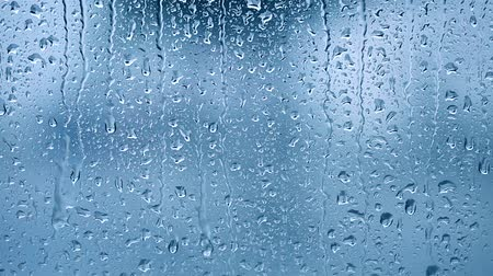 gota de chuva : Raindrops on the window, abstract background. Blue tone