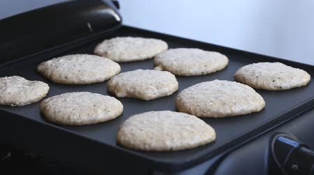 блин : Cooking home made oat pancakes on electric barbecue, closeup