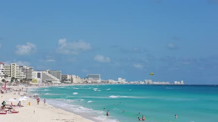 meksyk : Mexico, Cancun - January 16, 2016: People having a vacation on caribbean sea beach with turquoise water and white sand. Seaside resorts along the coastline