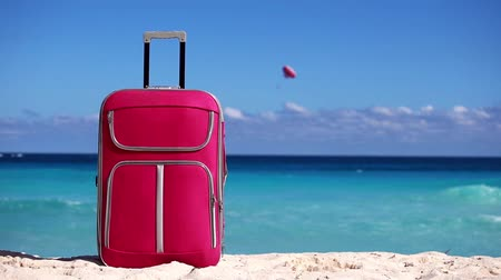 vacation destination : Suitcase on sandy tropical beach. Vacation concept
