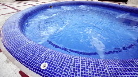 fizzing : Pool made with blue mosaic. fizzing water