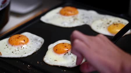 scrambled eggs : Cooking fried eggs on electric barbecue
