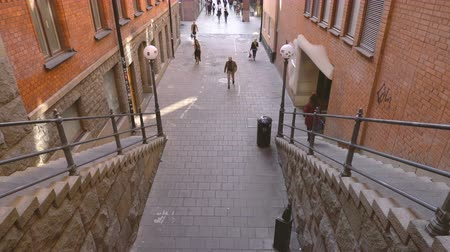 estocolmo : City street with stairs at downtown. People walking along the walkway