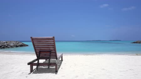 chaise longue : One wooden sunbed on tropical calm beach Stock Footage