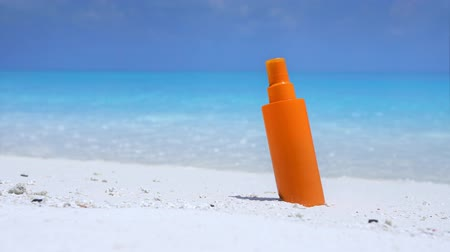 pristine : Sunscreen protection cream on white sand against turquoise sea water