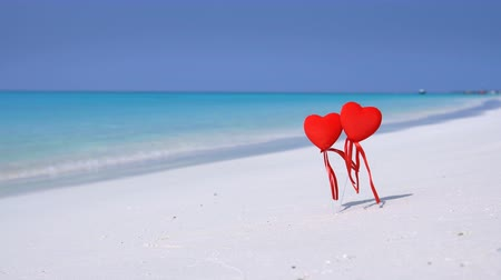 sand bank : Two red heart shapes on Maldivian beach