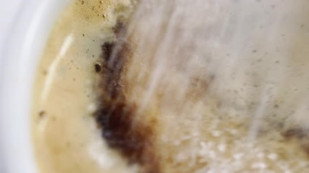 fizzing : Dropping shugar into cup with coffee Stock Footage