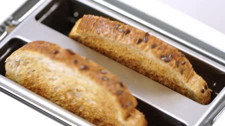 roaster : Fresh bread putting in white modern toaster machine Stock Footage