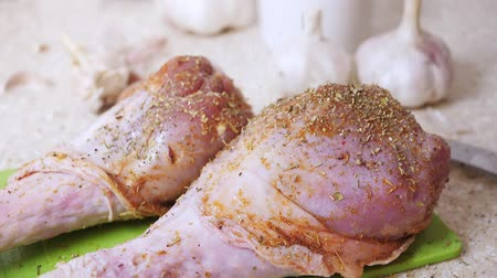 chicken recipes : Falling down dressing herbs on uncooked turkey legs at the kitchen